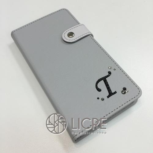 手帳型スマートフォンケースをオリジナルデザインでスワロフスキーデコレーション
